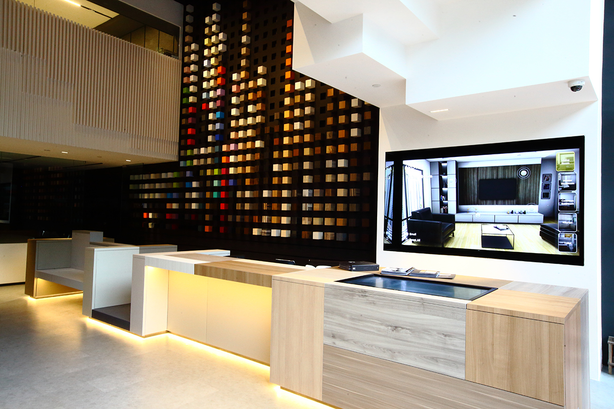 A large wall displays Arova's wide array of colours and textures for up-close exploration at the showroom.
