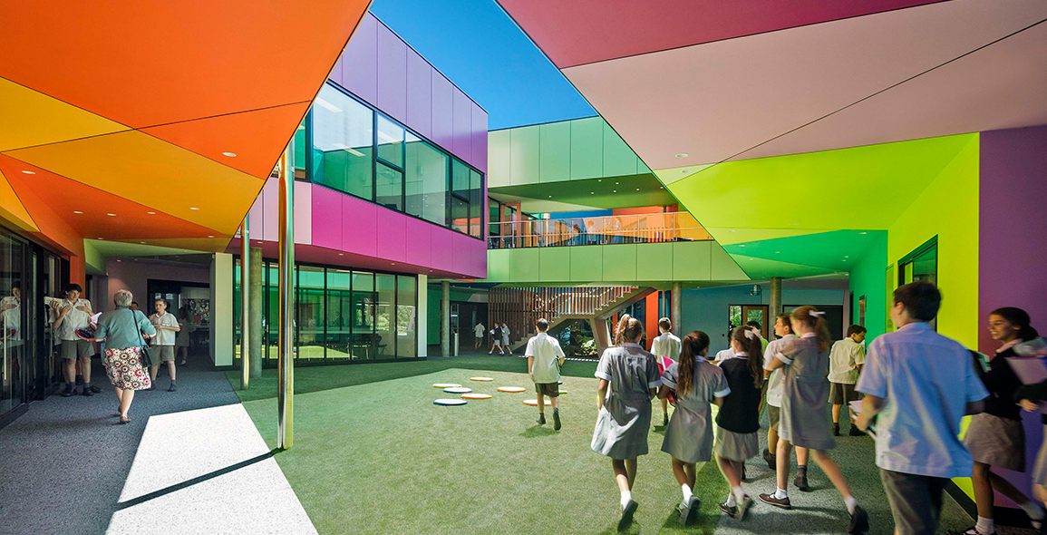 Students walk through the internal courtyard feeling cheerful and energetic with the pop of zesty colours