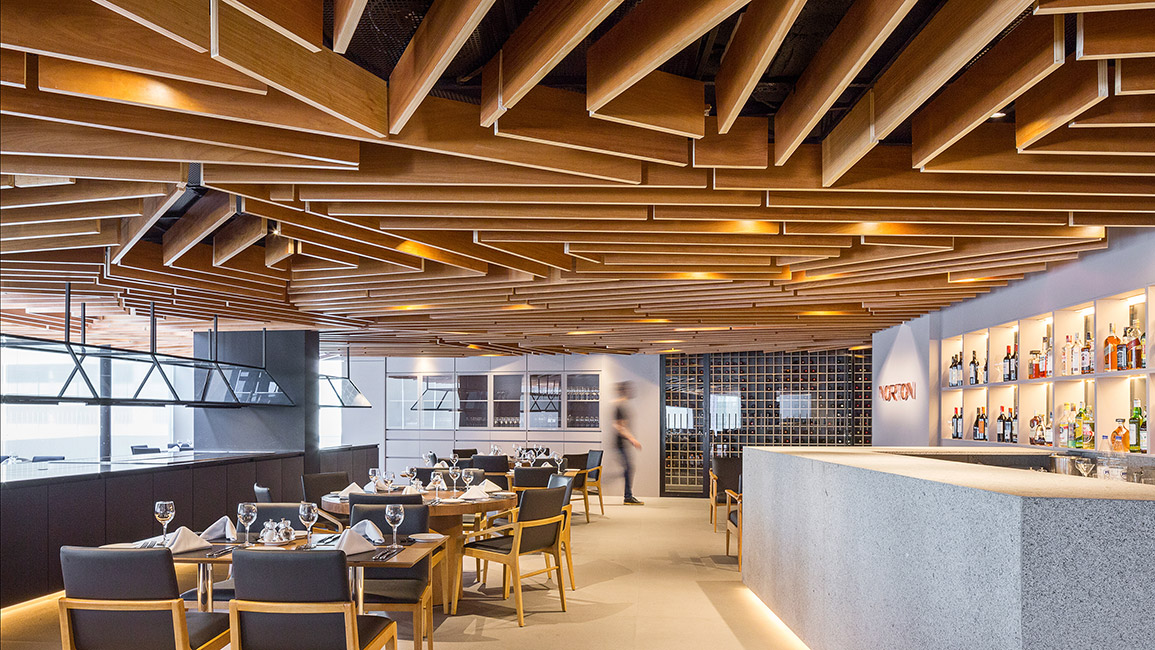Inside the dining area, the wooden feature looks quirky but inviting at the same time