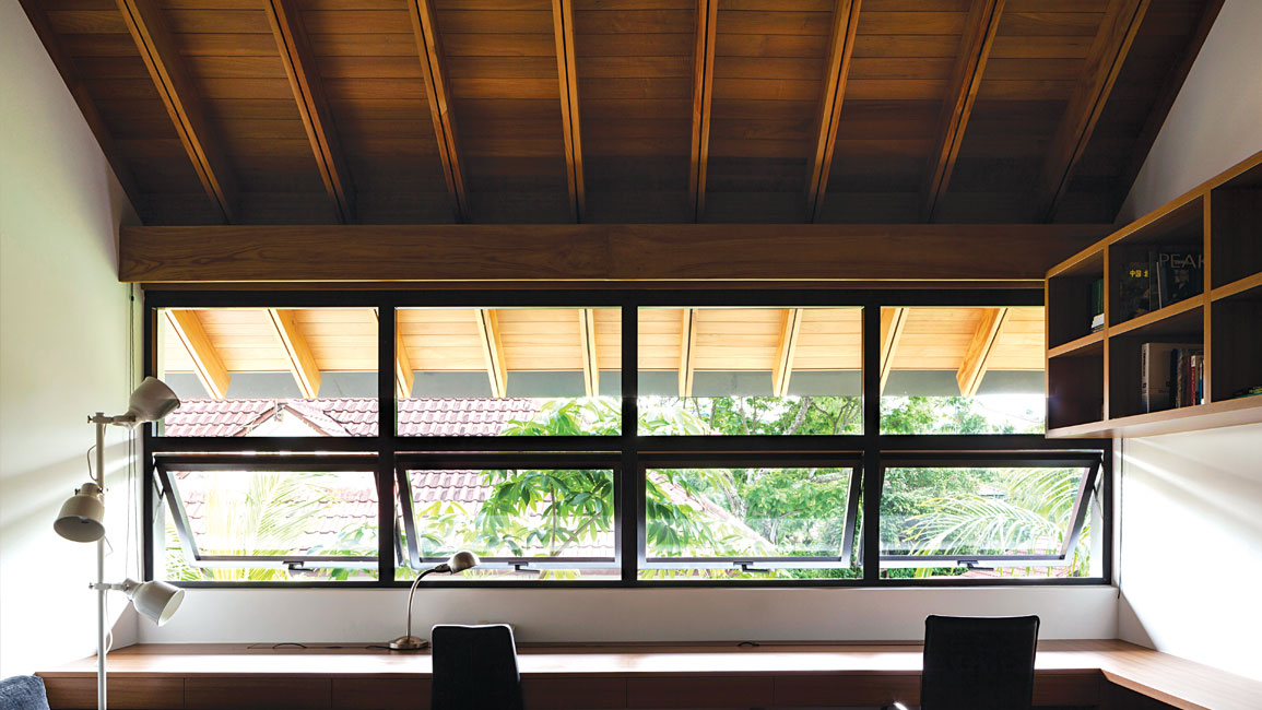 Within the house, timber is used to clad the soffit and make the joinery, continuing the warm, tactile language of the roof.