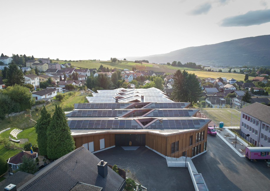 Solar panels cover the roof of the school