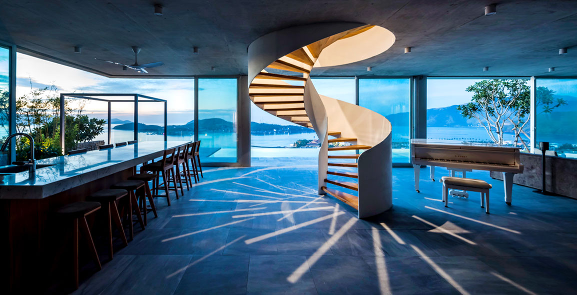 A scuptural spiral staircase connects the two floors and also demarcates the living lounge and kitchen and dining area.